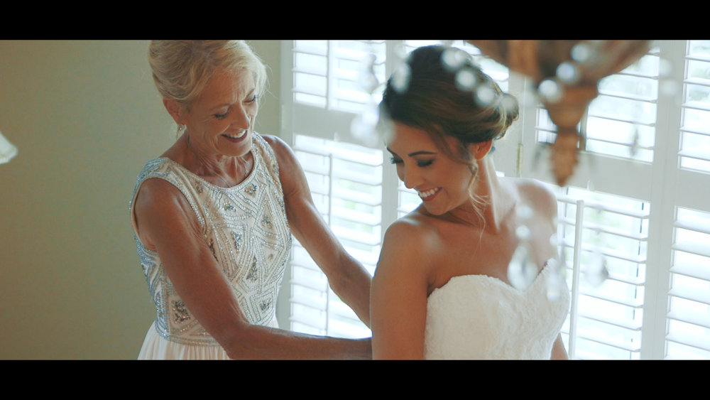 Hannah and her mother zipping up the wedding dress!
