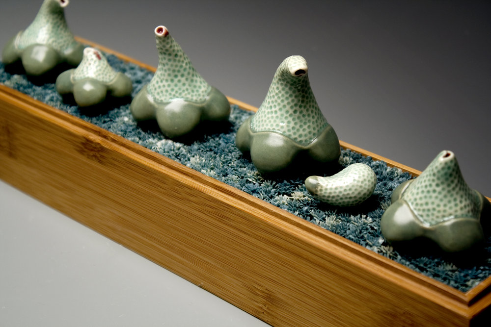 "Identity Porcelain, Plastic, Bamboo Cone 6 oxidation 10"" x 2.5"" x 4"""