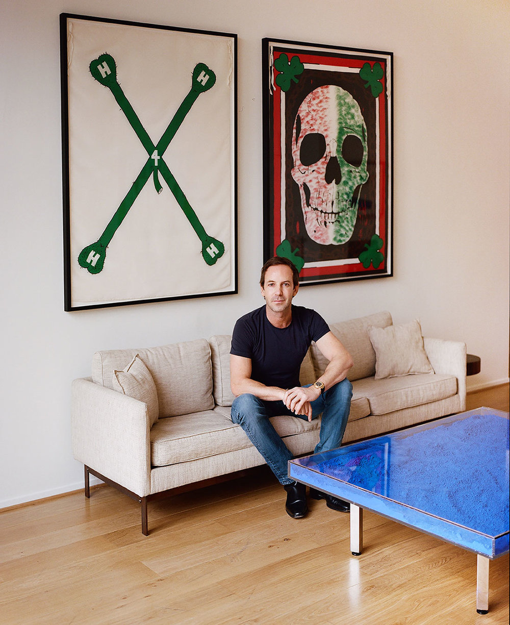 Charles Riva at home in Brussels. On the wall: Mike Kelley \ Heavy-Hangin'-Horny, Emerald Eyehole, 1989. In front: Yves Klein \ Table Bleu Klein, 1961/1963. © Eva Donckers for Collecteurs