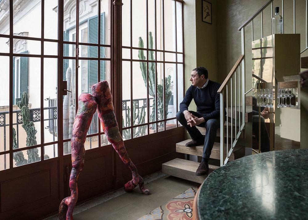 Fabio Agovino at home in Naples.©Maurizio Esposito for Collecteurs. Artworks [left to right]:Athena Papadopoulos \ Stumpin' & Bumpin II , 2016 - Cheyney Thomson \ Pedestal 17 , 2011 - Gedi Sibony \ Migratorius , 2013