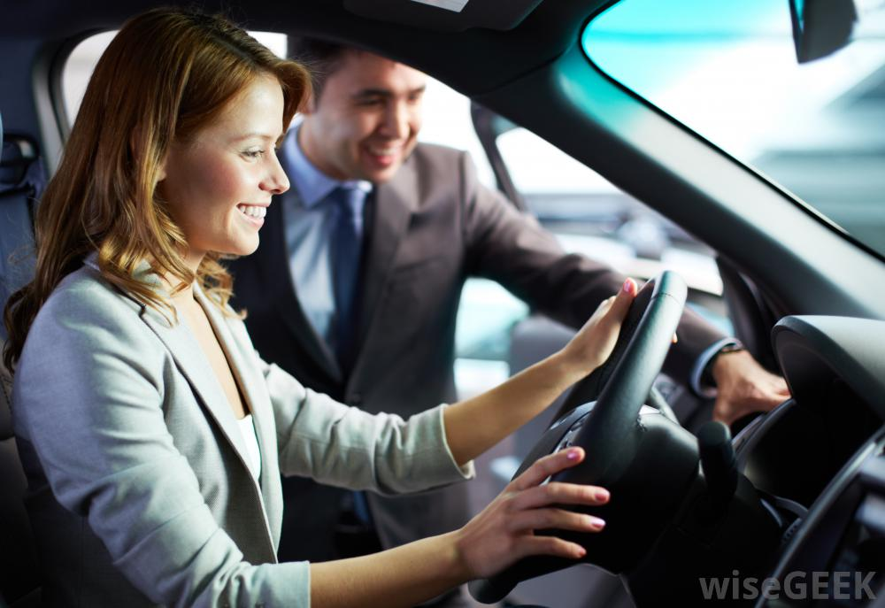 salesman-showing-woman-car-interior.jpg