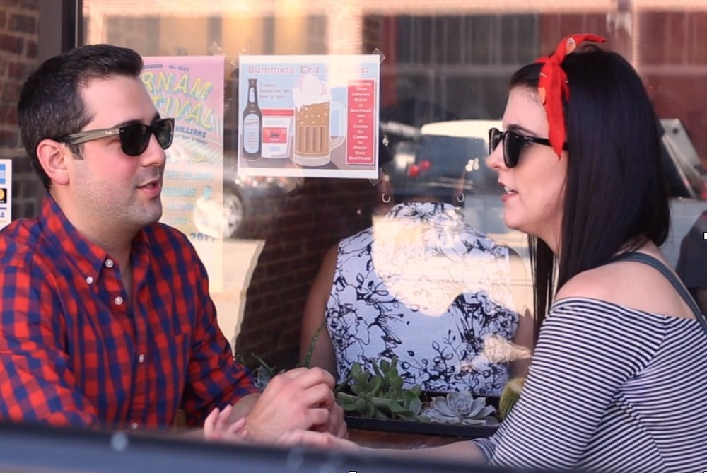 couple talking with sunglasses at ice cream shop