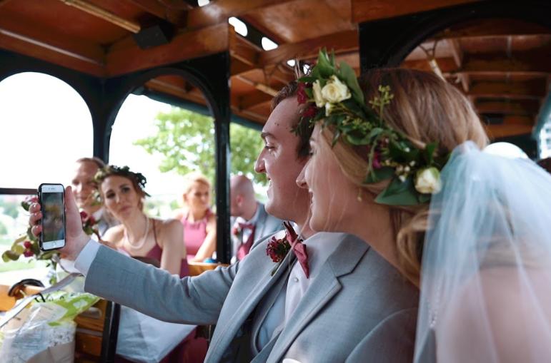 bride and groom taking a selfie