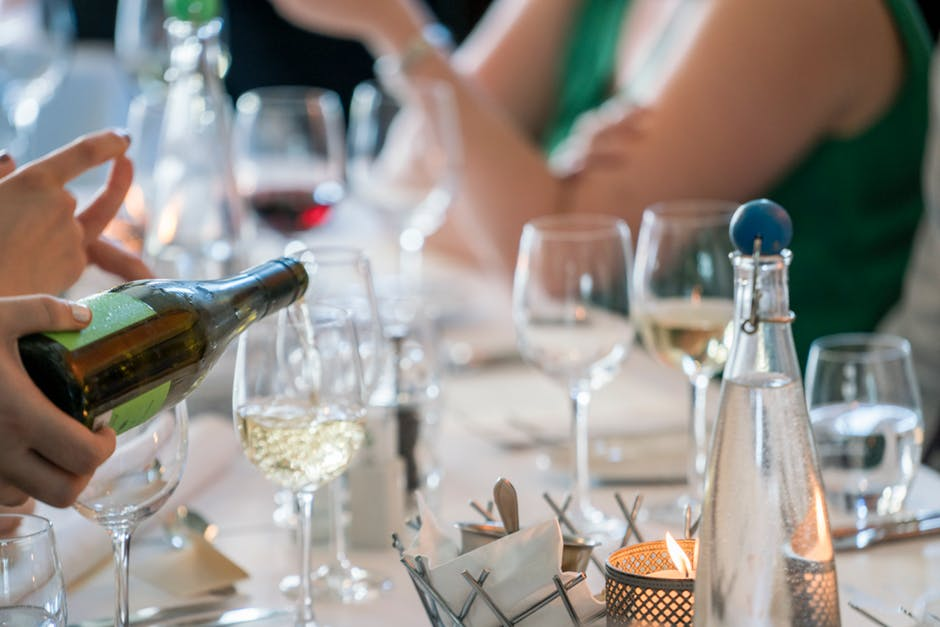 champagne being poured into glasses on a table