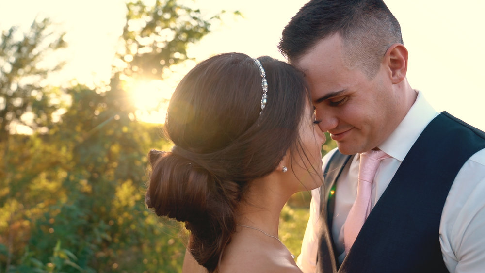 newlywed couple at sunset
