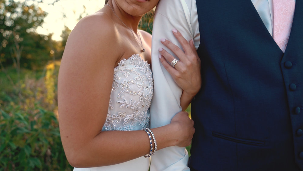 bride holding grooms arm