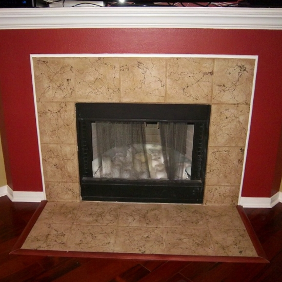 A stone tile carpet can continue down on the floor in front of the fireplace.