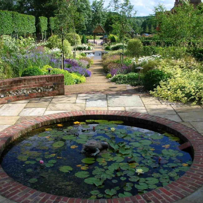 2.8.1Elegant-Round-Pond-and-Lotus-on-Stone-Paver-also-Various-Plant-as-Pond-Landscaping-Idea.jpg