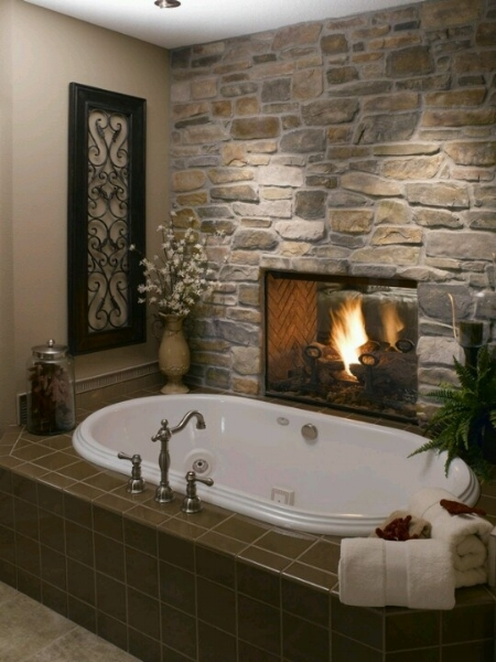 A stone fireplace pairs nicely with a tub.