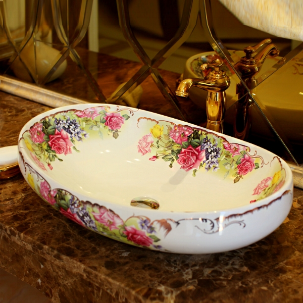 Oval cermaic vessel sink.
