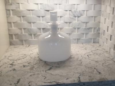 White basketweave behind this kitchen niche.