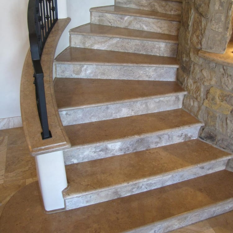 This is truly gorgeous and timeless way to use different types of stone which doesn't involve a countertop situation.