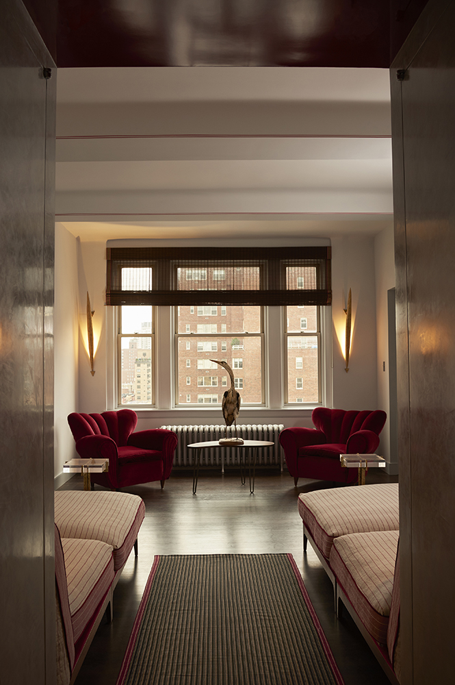 Upper East Side Penthouse Manhattan | New York   This corner apartment overlooking the beautiful NYC skyline and flooded with light, is the ideal hideaway.  One discovers - passing a mysterious shady entrance - a world of multiple shades of grey with touches of red  and ends up in a library metamorphosed into a stunning shoe shelve.  In collaboration with Cicognani Kalla Architects