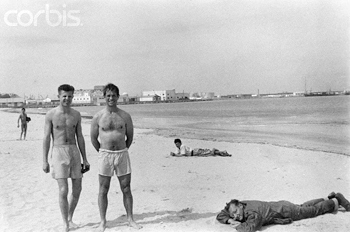 peter-orlovsky-jack-kerouac-and-william-burroughs-relaxing-on-beach.jpg