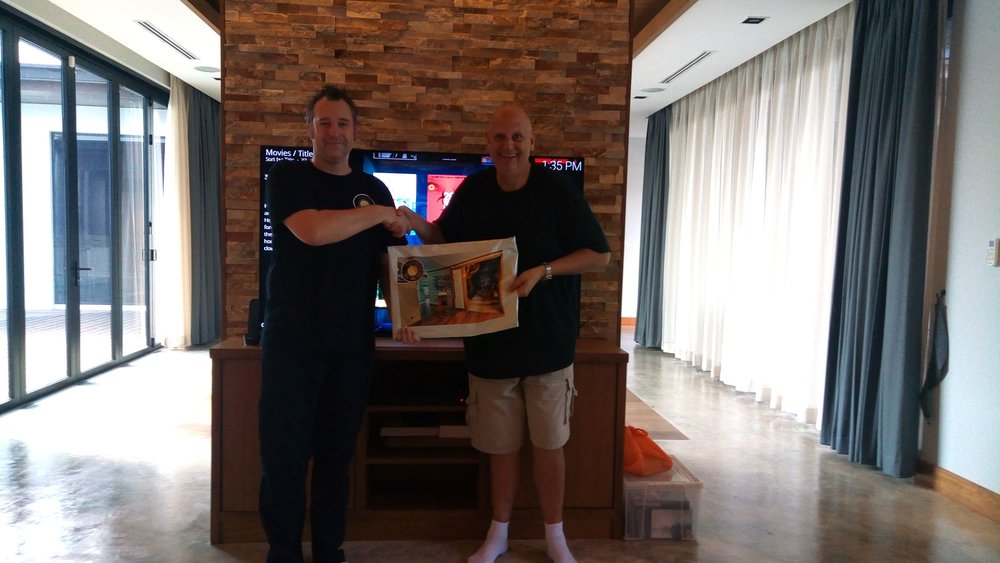 H3 Digital MD Ben Hobbs presents Gerry with his Smart Home handover pack.