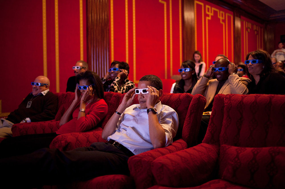 Barack Obama watching Superbowl on the big screen at the Whitehouse Theatre.