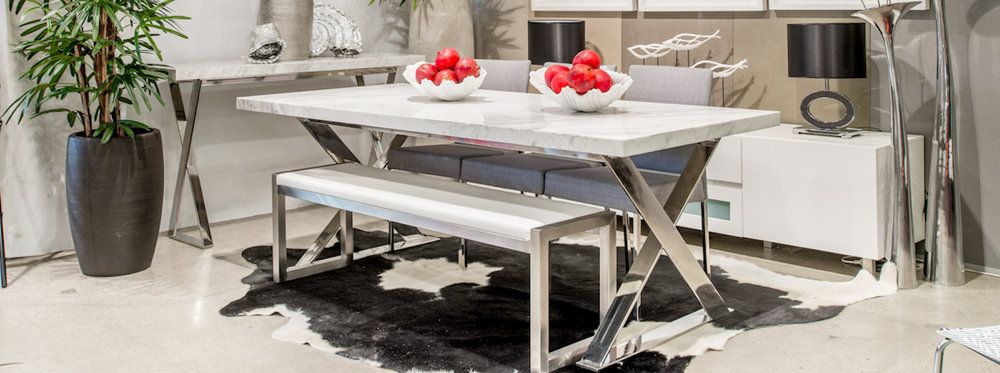 Lyn Ceaser Stone Dining Table from Moss Furniture.