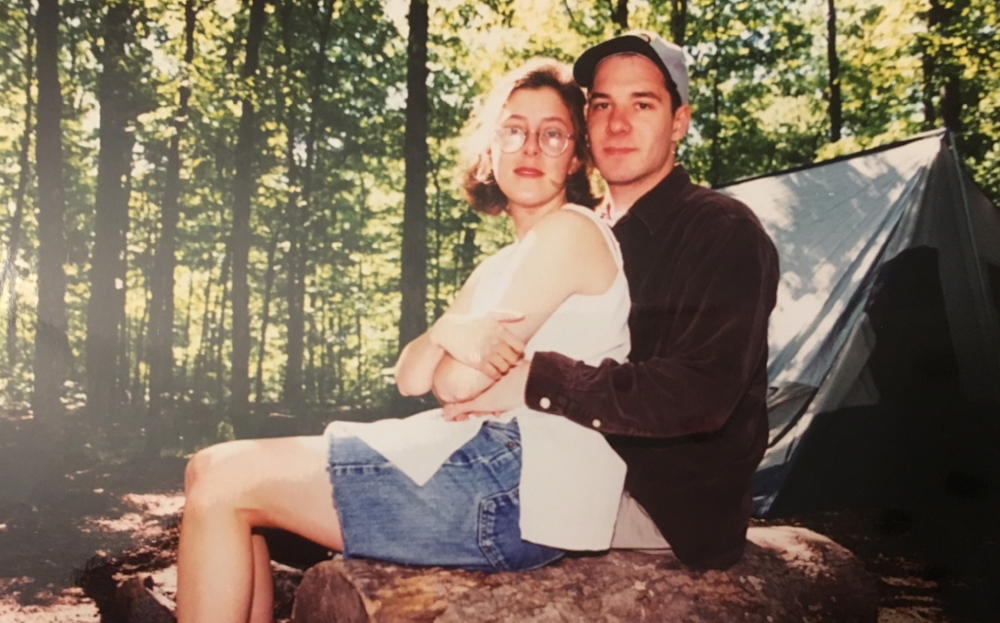 MAY 1994 Brian and Kathy leave on their honeymoon for a cross country camping trip where on the first night they came back from the bathroom to find a raccoon on top of the picnic table enjoying a bag of their tortilla chips.