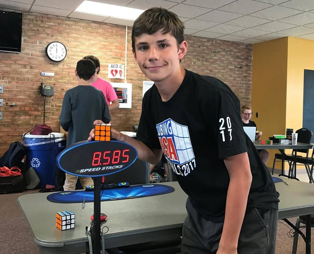 JULY 2016   Weird sport alert! You probably know the Rubik's Cube and you probably know there are people that can solve the puzzle really fast, but did you know there is an actual sport called Speedcubing. Well, there is and our son Owen competes all over the country solving any number of multi-sided, multi-shaped puzzles. And having a cubing kid automatically makes you a cubing parent, which is why when Brian isn't shooting pictures, you can find him in some convention hall or school gymnasium watching Owen compete. Just don't ask him to wear one of the Cubing Dad t-shirts.