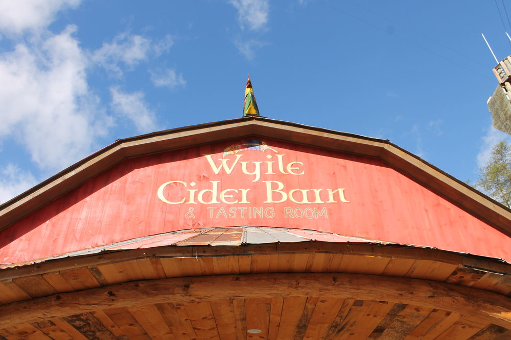Beautiful blue sky and Cider Barn building