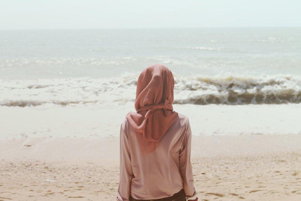 women in hijab at beach.jpeg