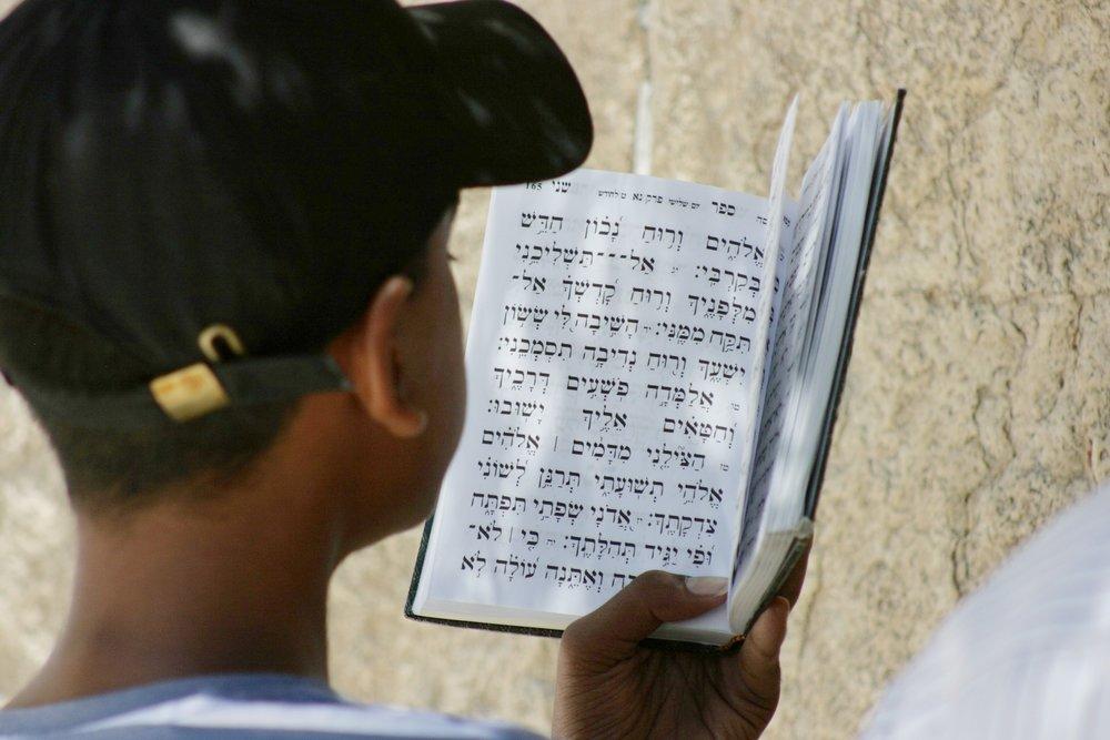 western wall boy with prayer book.jpg