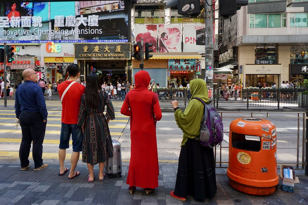 It's common to see women wearing headscarves in public religiously diverse Hong Kong. But in Europe, it's more controversial.