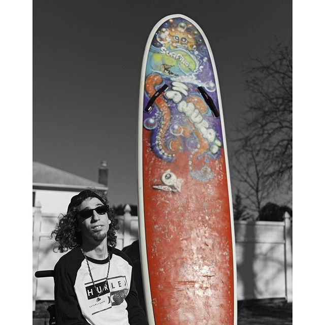 Dylan Hronec-  Dylan with his custom Wavejet surfboad which the foundation purchased for him to help him surf more indepentantly.