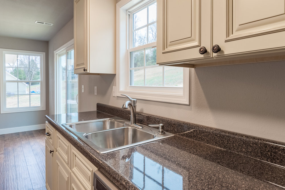 Kitchen offers sun filled spaces and wonderful attention to detail.