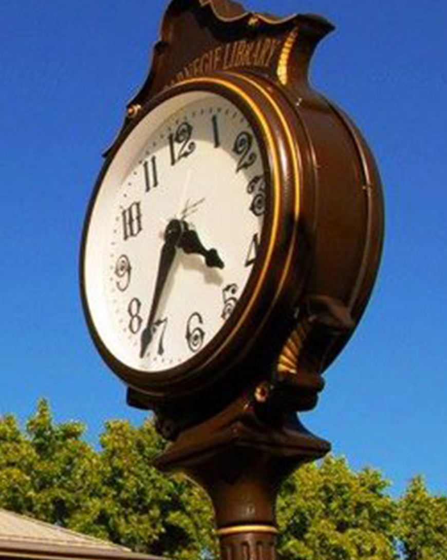 """Clock Dedication    The Howell Carnegie Library received a grant for """"The City of Howell Clock.""""The clock was dedicated in honor of Edward and June Kellogg's service to the community by former Howell Major, Geraldine Moen."""