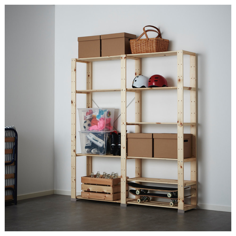 Great bookshelf that is totaly customiazable to your space. The light wood looks great with white baskets as well!