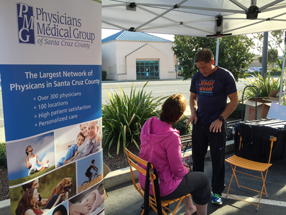 Dr. Hopkins giving foot checks at whole foods.jpg
