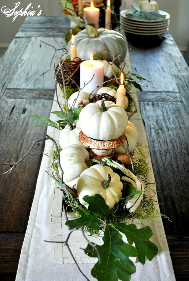 Get those white pumpkins out, table runner, twigs from your backyard, and candles are you are done!