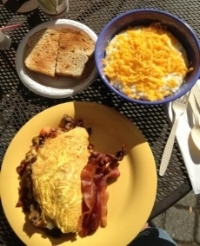 Al fresco  is a great way to enjoy an omelet with bacon, Gourmet Grits with cheese, toast, and coffee....