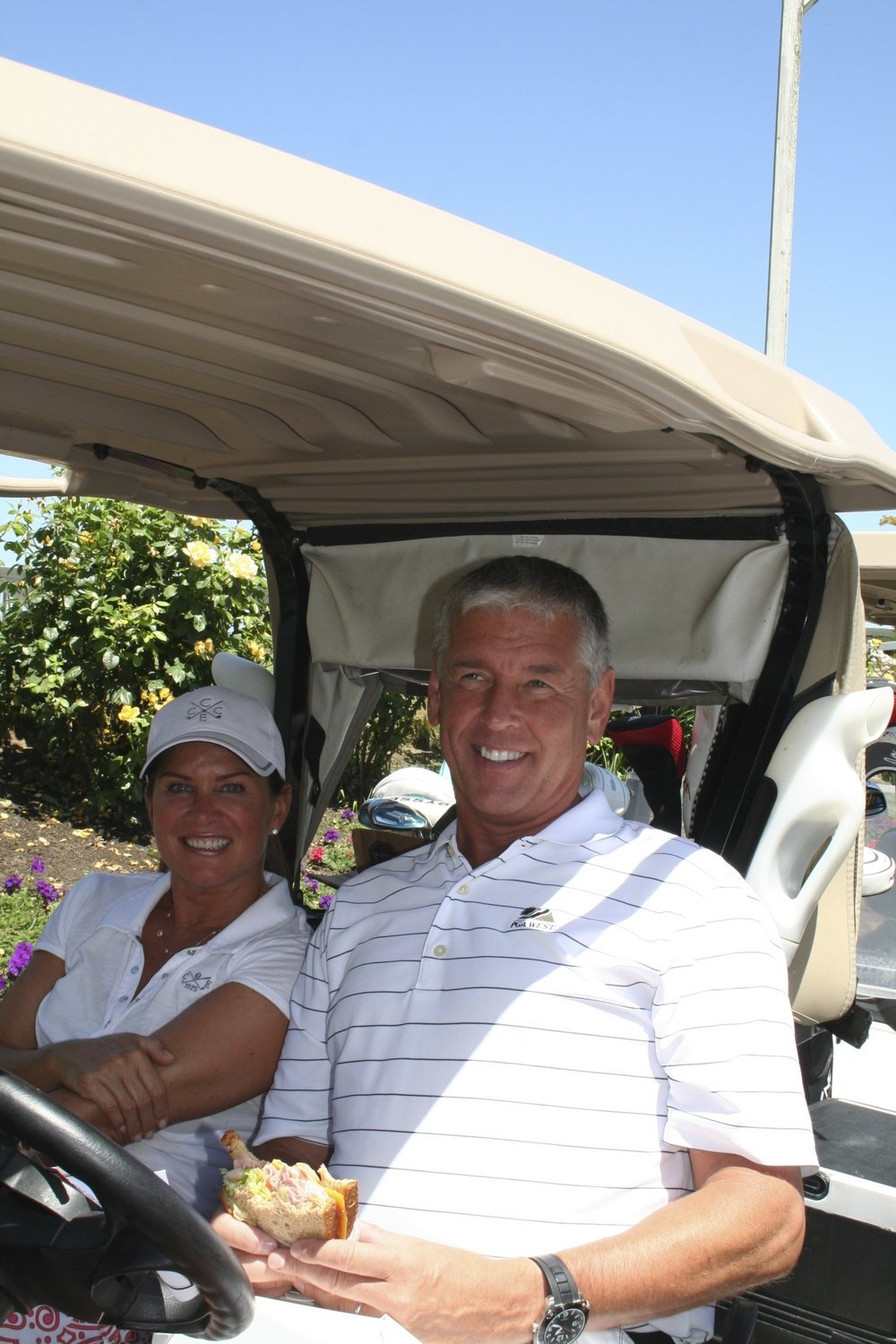Guten Foods President Suzeanne Mager (left) and Vice President, Rene Briede, at the annual Guten Foods Golf Tournament at Langdon Farms Golf Club to raise money for Zenger Farm and New City Initiative .