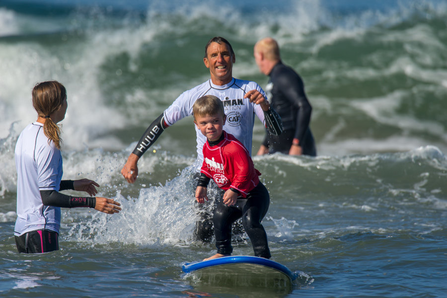 Sebastian (surfing) and Dave Scott, the Kelly Slater of Triathalons   photo: Sean Evans