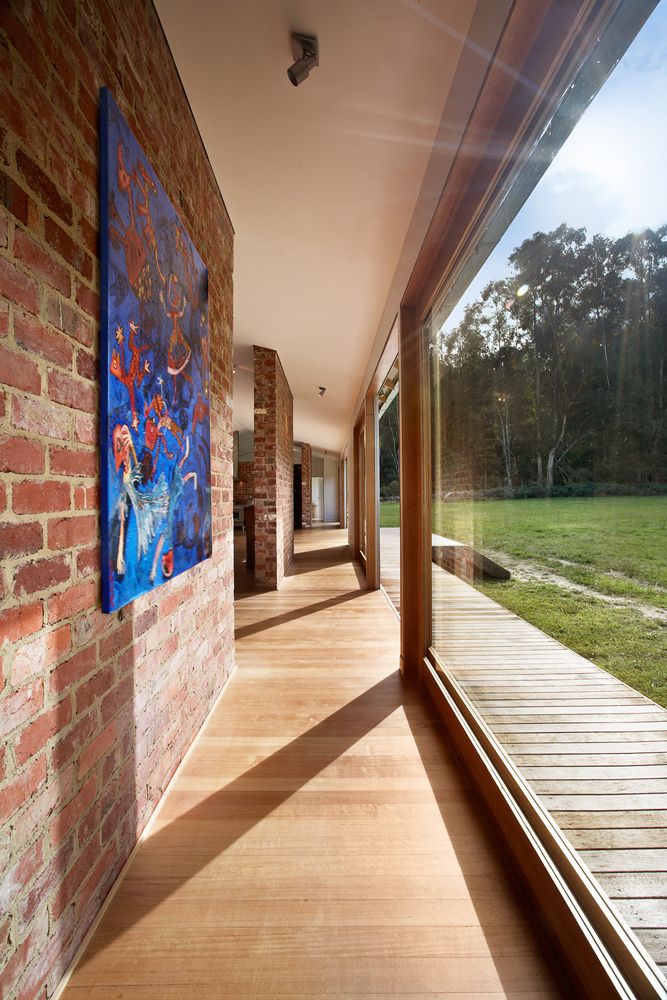 Reclaimed Brick Walls Hit with Natural Sunlight from Full Length Sliding Glass Doors