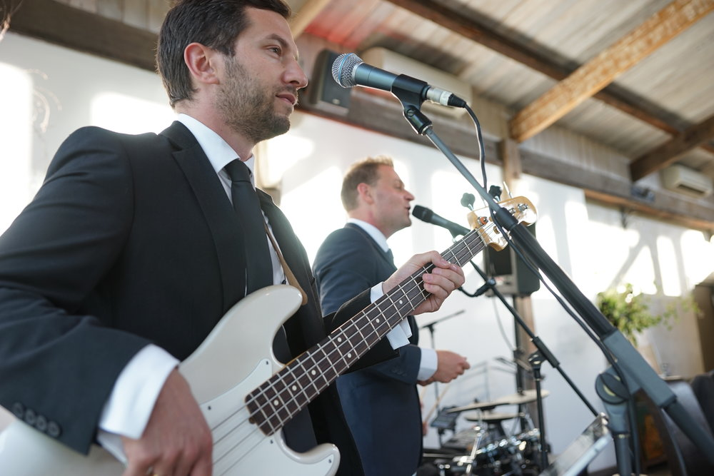 Steven performing at a wedding with Brandon