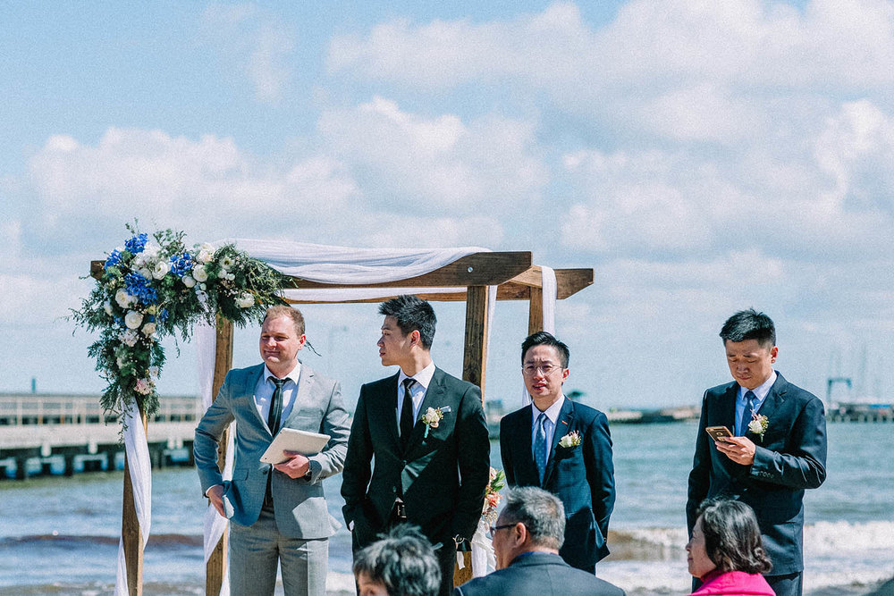 Brandon performing the role of celebrant for one of our clients wedding ceremony at Brighton Beach.  The reception followed at the Middle Brighton Baths.
