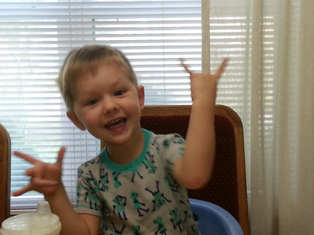 "Nana's not-so-subtle attempt to get Jacob to do the hook'em sign. It just looks like ""Rock On"" to this Aggie."
