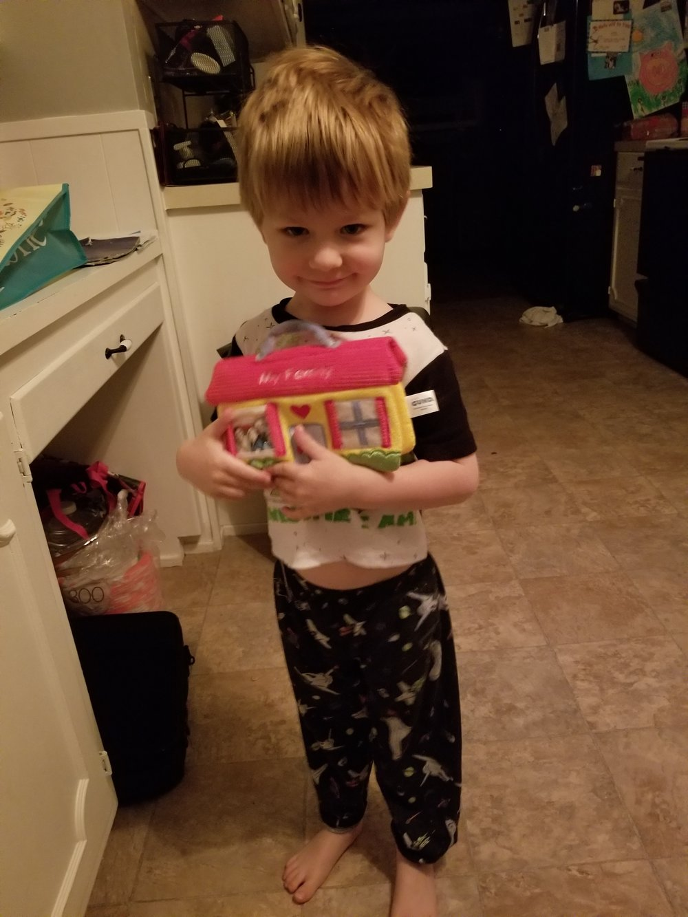 I had to add this picture! Jacob loved this photo album. I love his bedhead and too small PJs!