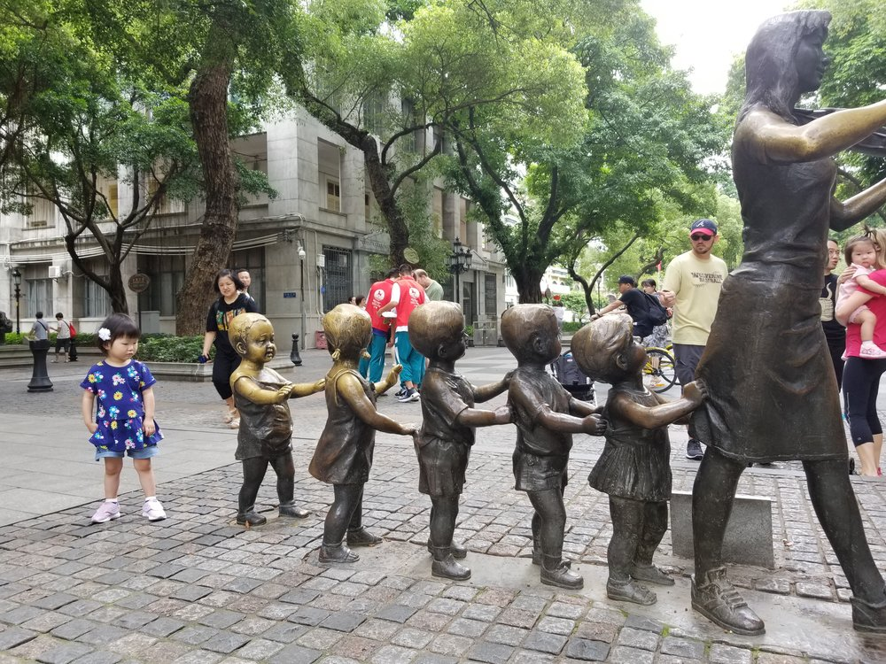 Taking a picture with the statue popular among adoptive families.