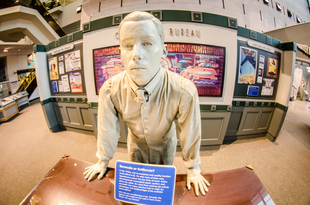 """It might as well be booked by this actual statue.  photo credit: """"Travel agent statue""""  by    m01229    is licensed under   CC BY 2.0"""