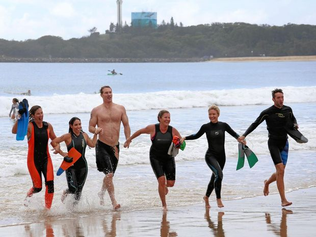 FINISH LINE: Teachers from Nambour Special School's Wahoo 2 team take on the Island Charity Swim 2017 .     Photo: Tessa Mapstone