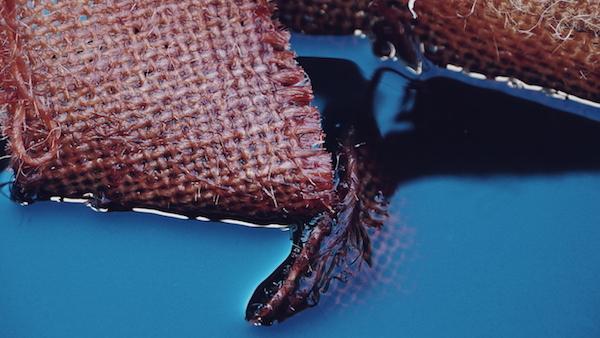 Hessian strips in Camwood dye solution