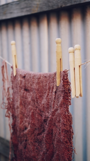 Hessian dyed with Camwood drying