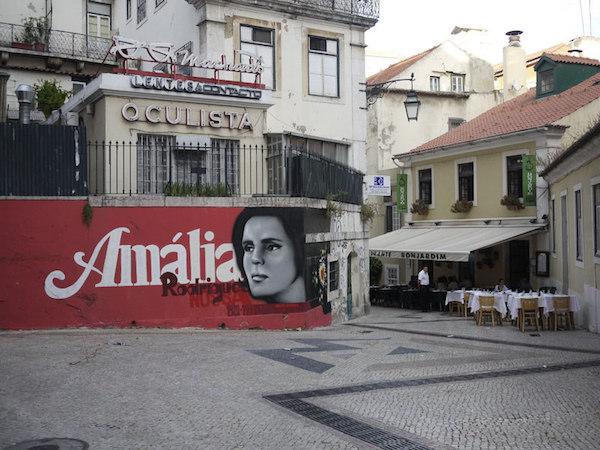 The streets of Lisbon. Wall art of Amalia Rodrigues. Image courtesy of  Roland Johnson .