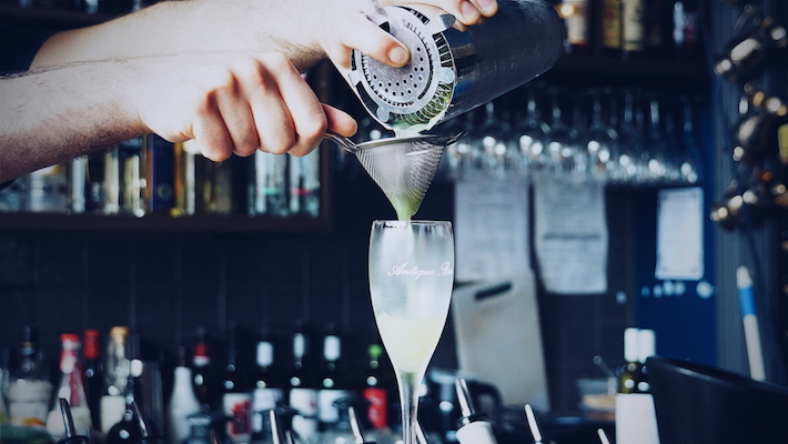 Pouring the green hornet components into a champagne glass