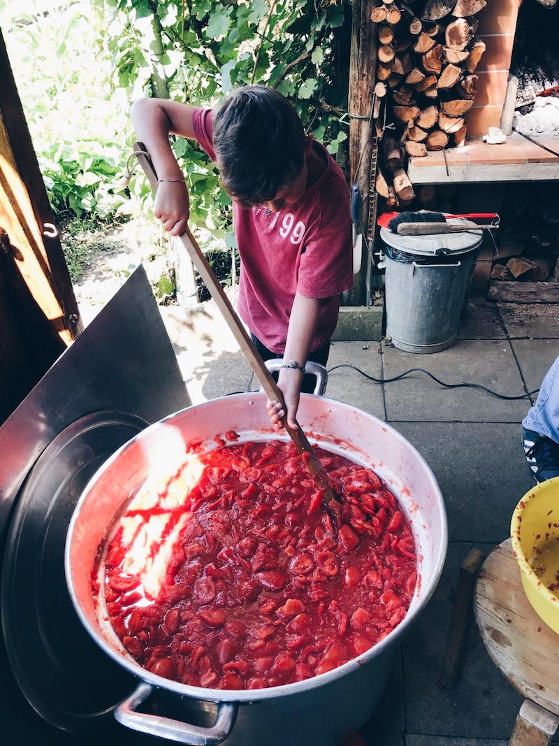 Stirring the tomatoes.jpg