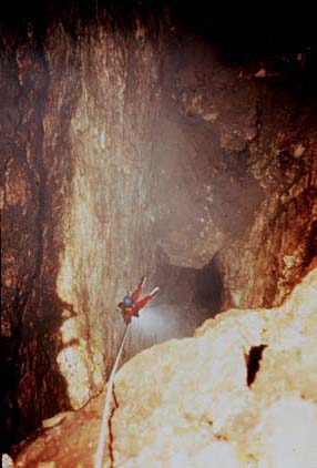 Sump 7: The Ultimate Speleological Obstacle. Noel Sloan is shown here descending the 55 meter freefall drop leading directly into Sump 7, the most remote underwater tunnel discovered in the Cueva de la Peña Colorada. [photo �1984 Bill Stone]